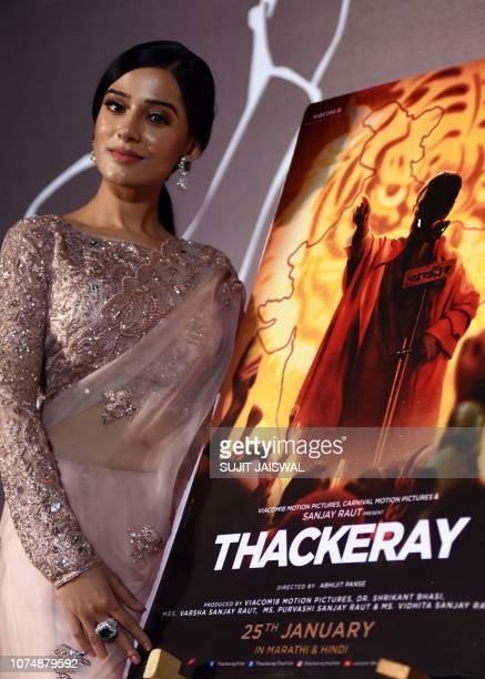 Indian Bollywood actress Amrita Rao poses during the trailer launch of the upcoming biographical drama Hindi film 'Thackeray' in Mumbai on December...