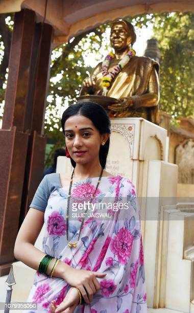 Indian Bollywood actress Amrita Rao poses near the statue of Shiv Sena founder Balasaheb Thackeray's wife Meenatai Thackeray during the promotion of...