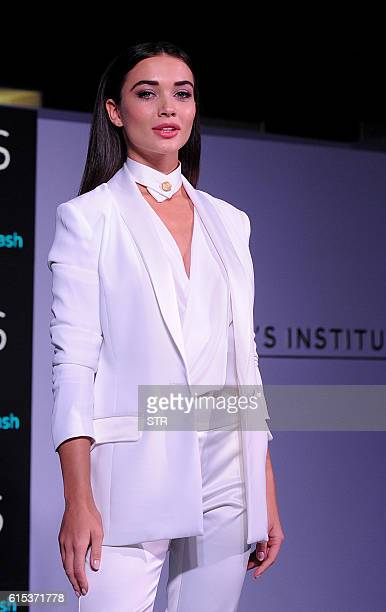 Indian Bollywood actress Amy Jackson poses for a photograph during a promotional event in Mumbai on October 18 2016 / AFP / STR