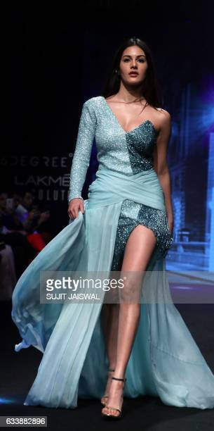 Indian Bollywood actress Amyra Dastur showcases a creation by designer Karan Malhotra at the Lakme Fashion Week Summer Resort 2017 in Mumbai on...