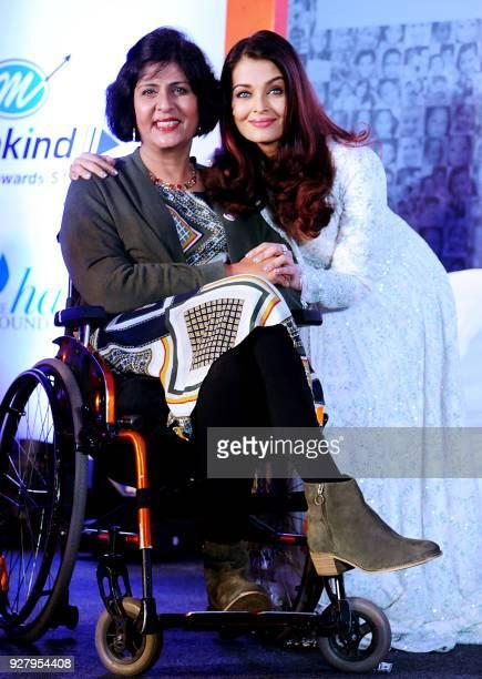 Indian Bollywood actress and and Smile Train Goodwill ambassador Aishwarya Rai Bachchan poses with Indian Olympic Paralympian athlete Deepa Malik...