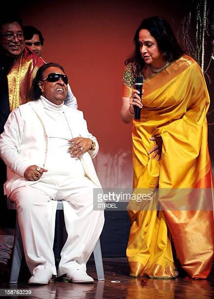 Indian Bollywood actress and Bharatanatyam dancer Hema Malini speaks with Indian music composer and lyricist Ravindra Jain during a tribute to her...