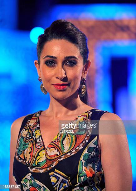 Indian Bollywood actress and judge on the Indian Princess and International Princess 2013 Karishma Kapoor looks on during the show in Mumbai on March...