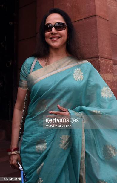 Indian Bollywood actress and politician Hema Malini looks on as she arrives for the monsoon session of Parliament in New Delhi on July 18 2018