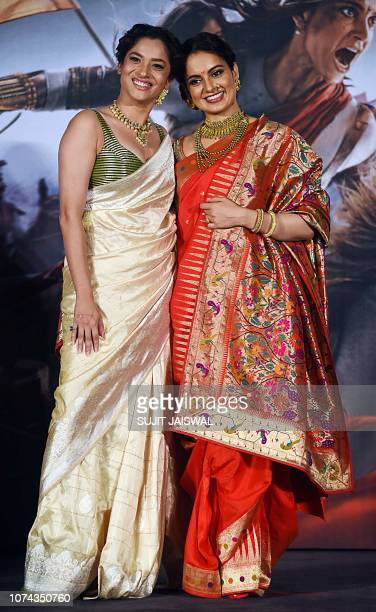Indian Bollywood actress Ankita Lokhande and Kangana Ranaut pose for photographs during the trailer launch of the Indian historical biographical film...