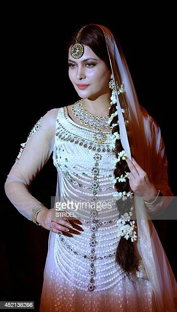 Indian Bollywood actress Ankita Shorey models a creation during Indian International Jewellery Week 2014 in Mumbai on July 14 2014 AFP PHOTO/STR