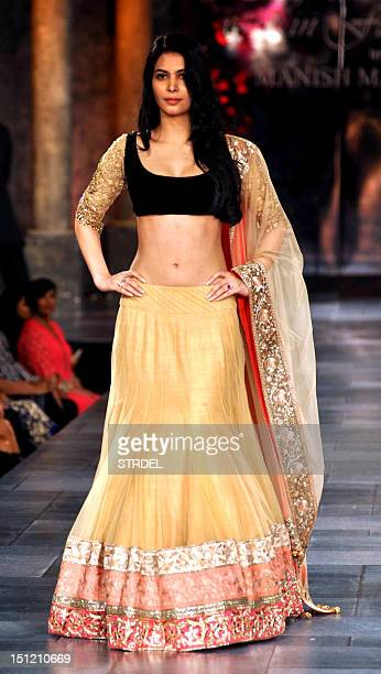 Indian Bollywood actress Ankita Shorey poses during a fashion show for The Mijwan Welfare Society in Mumbai late September 3 2012 AFP PHOTO/STR
