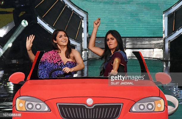 Indian Bollywood actress Anushka Sharma and Katrina Kaif take part in the promotion of the Hindi film 'Zero' at the Indian television singing reality...