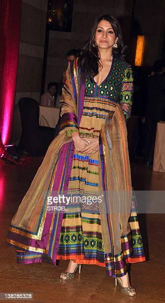 Indian Bollywood actress Anushka Sharma attends the wedding reception of actors Ritesh Deshmukh and Genelia D'Souza in Mumbai on February 4 2012 AFP...
