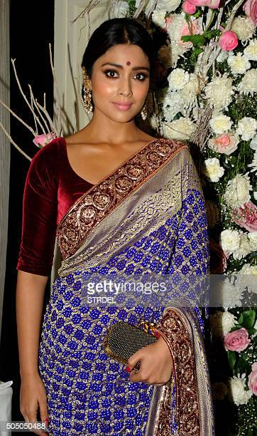 Indian Bollywood actress Asin Thottumkal poses for a photograph during the Manish Malhotra 'Regal Threads' charity fashion show in Mumbai on late...