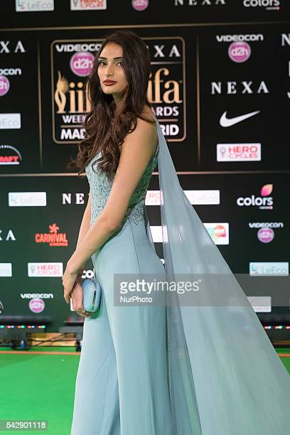 Indian Bollywood actress Athisa Shetty poses on the green carpet as she arrives to the 17th edition of IIFA Awards in Madrid on June 24 2016