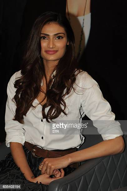 Indian Bollywood actress Athiya Shetty poses for a photograph during the launch of the book 'Bag It All' by Nina Lekhi in Mumbai on February 15 2017...