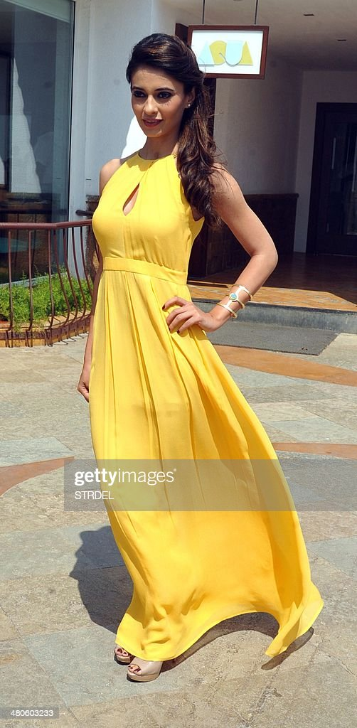 Indian Bollywood actress Ayesha Khanna poses for a photograph during a promotional event for the forthcoming Bollywood film 'Dishkiyaaoon' produced by Shilpa Shetty and directed by Sanamjit Singh Talwar in Mumbai on March 25, 2014.