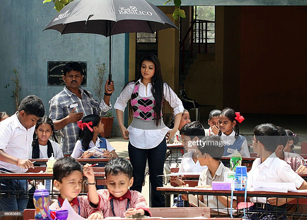 Indian Bollywood actress Ayesha Takia is seen among children