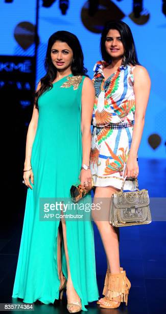 Indian Bollywood actress Bhagyashree with her daughter Avantika pose for a photograph during the Lakme Fashion Week Winter/Festive 2017 in Mumbai on...