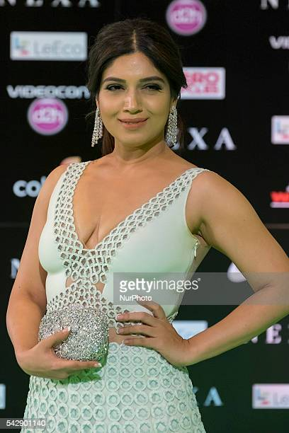 Indian Bollywood actress Bhumi Pednekar poses on the green carpet as she arrives to the 17th edition of IIFA Awards in Madrid on June 24 2016