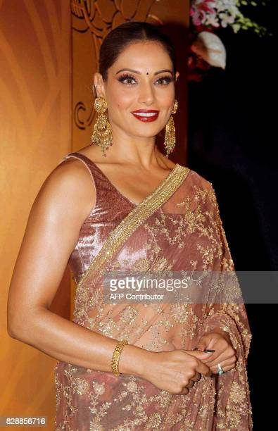 Indian Bollywood actress Bipash Basu poses for a photograph during a promotional event in Mumbai on late August 9 2017 / AFP PHOTO / STR