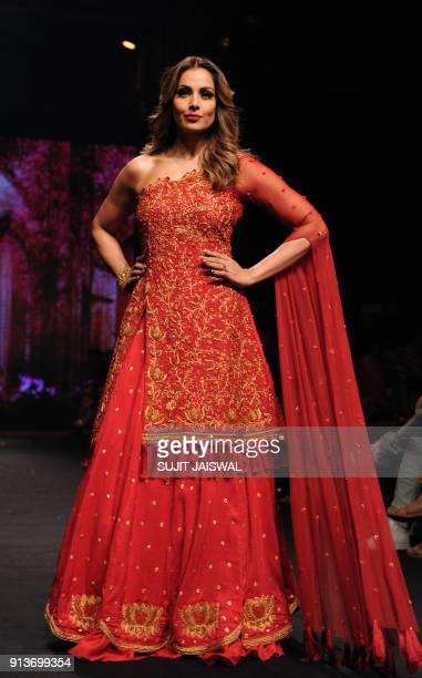 Indian Bollywood actress Bipash Basu showcases a creation by designer Reshma Kunni at the Lakmé Fashion Week Summer Resort 2018 in Mumbai on February...
