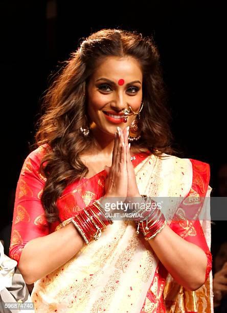 Indian Bollywood actress Bipasha Basu showcases a creation by designer Sanjukta Dutta during the Lakme Fashion Week Winter/Festive 2016 in Mumbai on...