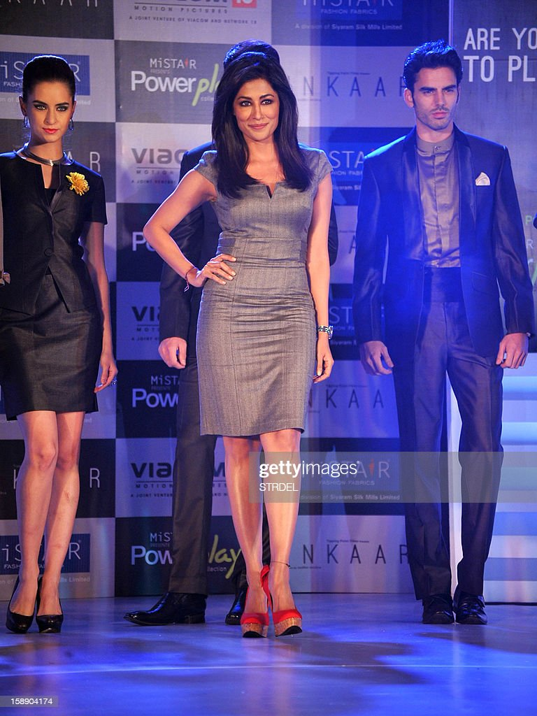 Indian Bollywood actress Chitrangda Singh (C) walks the ramp during a promotional event in Mumbai on January 3, 2013.