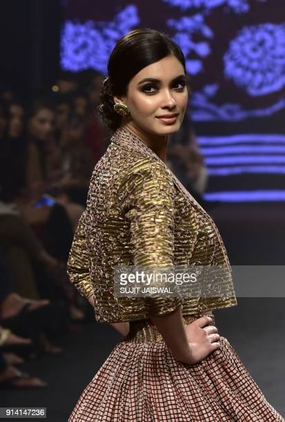 Indian Bollywood actress Daina Penty showcases a creation by designer Punit Balana at the Lakmé Fashion Week Summer Resort 2018 in Mumbai on February...