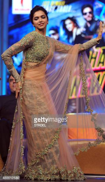 Indian Bollywood actress Deepika Padukone dances onstage during a promotional event for the forthcoming Hindi film 'Happy New Year' directed by Farah...