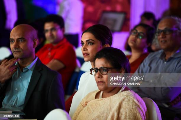 Indian Bollywood actress Deepika Padukone founder of the Live Love Laugh Foundation looks on during the unveiling event for a report on the public...