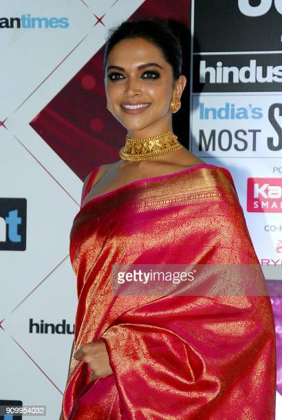 Indian Bollywood actress Deepika Padukone poses for a picture as she attends the 'HT India's Most Stylish Awards 2018' in Mumbai late on January 24...
