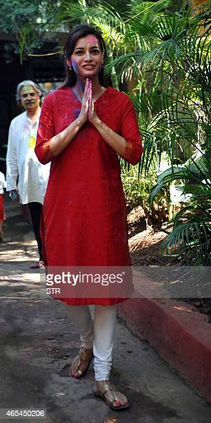 Indian Bollywood actress Dia Mirza celebrates Holi the 'festival of colours' in Mumbai on March 6 2015 AFP PHOTO