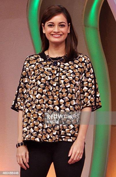 Indian Bollywood actress Dia Mirza poses for a photograph during a 'CLEANATHON' television campaign to promote cleanliness in Mumbai on December 14...