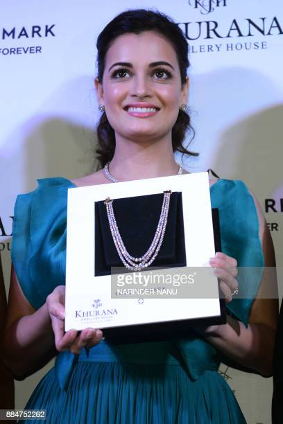 Indian Bollywood actress Dia Mirza poses for a picture during a promotional event for a jewellery brand in Amritsar on December 3 2017 / AFP PHOTO /...