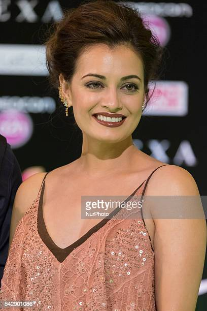 Indian Bollywood actress Dia Mirza poses on the green carpet as she arrives to the 17th edition of IIFA Awards in Madrid on June 24 2016