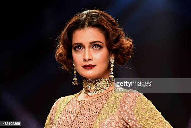 Indian Bollywood actress Dia Mirza showcases a creation during India International Jewellery Week 2015 in Mumbai on August 5 2015 AFP PHOTO