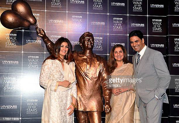 Indian Bollywood actress Dimple Kapadia poses with her daughter actress Twinkle Khanna and her soninlaw actor Akshay Kumar during the unveiling of a...