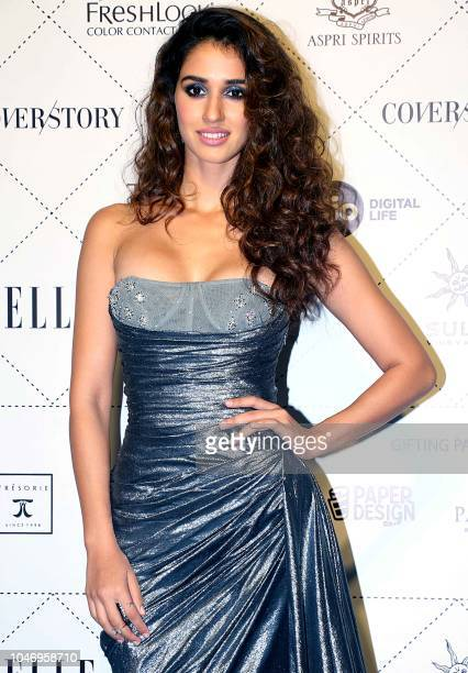 Indian Bollywood actress Disha Patani poses for a picture as she attends 'Elle Beauty Awards 2018' in Mumbai on October 06 2018