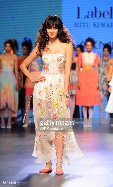 Indian Bollywood actress Disha Patani showcases a creation by designer Ritu Kumar at Lakme Fashion Week Winter/Festive 2017 in Mumbai on August 16...