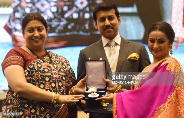 Indian Bollywood actress Divya Dutta receives the Best Supporting Actress award from Minister of Information and Broadcasting Smriti Irani as...