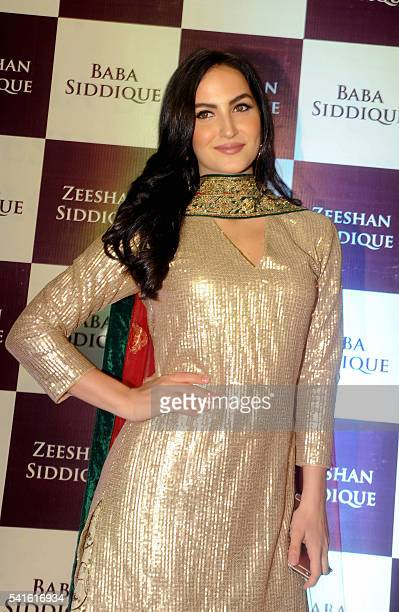 Indian Bollywood actress Elli Avram attends an Iftar party hosted by politician Baba Siddiqui during the Islamic holy month of Ramadan in Mumbai on...