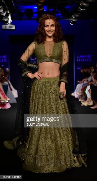 Indian Bollywood actress Elli Avram showcases a creation by designer Ekta at the Lakme Fashion Week Winter/Festive 2018 in Mumbai on August 25 2018