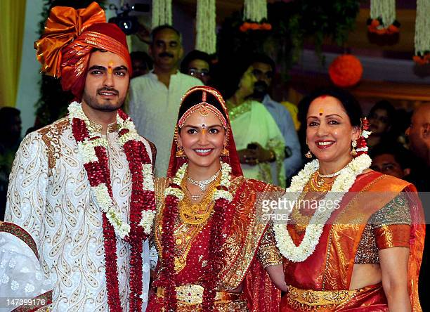 Indian Bollywood actress Esha Deol her mother and actress Hema Malini and groom Bharat Takhtani pose during their wedding in Mumbai on June 29 2012...
