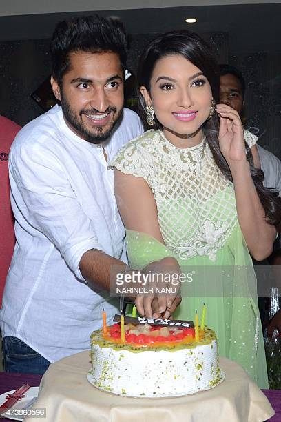 Indian Bollywood actress Gauhar Khan Punjabi singer and actor Jassi Gill pose during a promotional tour for the forthcoming Punjabi film 'Oh Yaara...