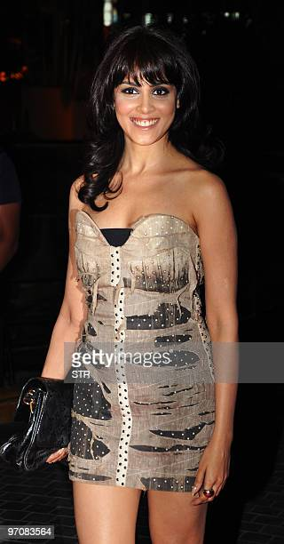 Indian Bollywood actress Genelia D�Souza arrives at the Film Fare Awards in Mumbai on February 25 2010 AFP PHOTO/STR