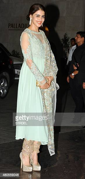 Indian Bollywood actress Genelia D'Souza arrives for the wedding reception of Bollywood actor Shahid Kapoor in Mumbai on July 12 2015 AFP PHOTO / STR
