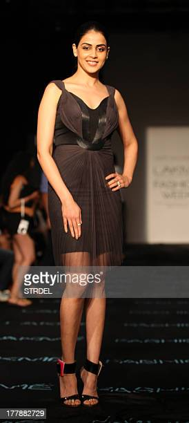 Indian Bollywood actress Genelia D'Souza poses during the Lakme Fashion Week Winter/Festival 2013 in Mumbai on August 25 2013 AFP PHOTO/STR