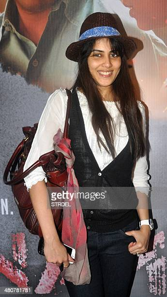 Indian Bollywood actress Genelia D'Souza poses for a photograph during a screening of Sri Lankan film Inam written directed and produced by Santosh...