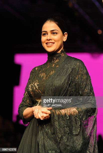 Indian Bollywood actress Genelia D'Souza poses for a photograph during Lakme Fashion Week Winter/Festive 2016 in Mumbai on late August 27 2016 / AFP...