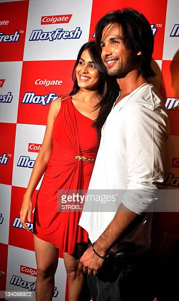Indian Bollywood actress Genelia D'Souza poses with actor Shahid Kapoor as they arrive to attend a Colgate MaxFresh function in Mumbai late November...