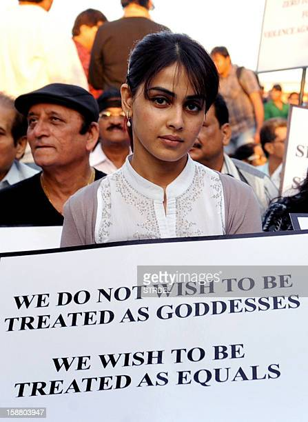 Indian Bollywood actress Genelia D'Souza takes part in a candlelight vigil in Mumbai on December 29 after the death of a gangrape victim from New...