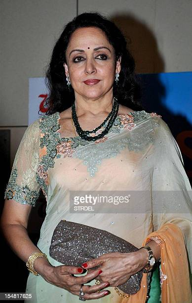 Indian Bollywood actress Hema Malini poses for a photo during the unveiling of the book Sexy@ Sixty by Namita Jain in Mumbai on October 26 2012 AFP...