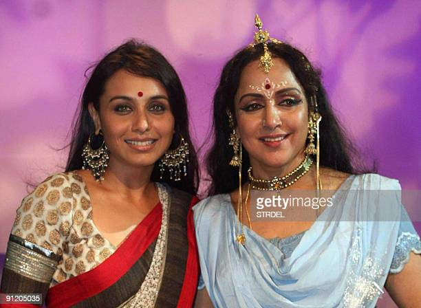 Indian Bollywood actress Hema Malini poses with fellow artiste Rani Mukherjee after performing a dance routine at a Durga Puja Pandal in Mumbai late...